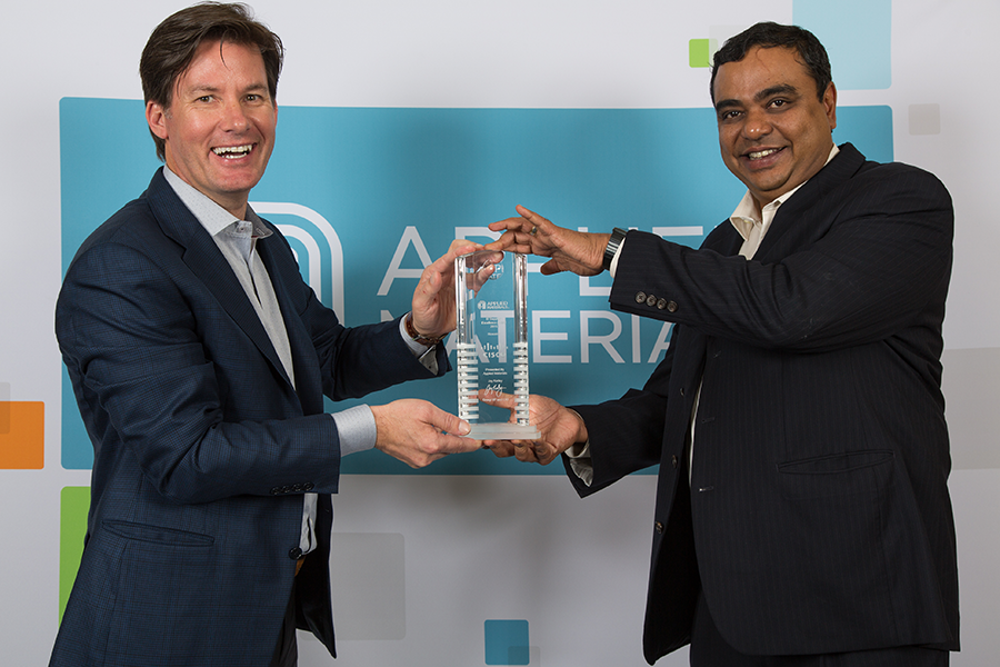 Hari Jayaram (right), Applied Materials VP of Enterprise Infrastructure Solutions and Support, presents the IT Supplier of the Year award to Sylvain Tremblay (left), VP of Commercial Sales at Cisco.