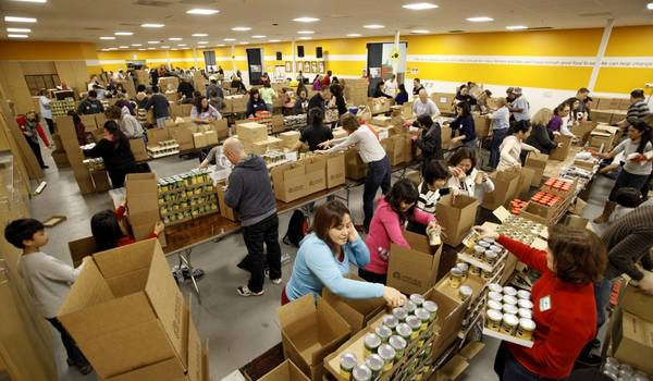 Employees Pack 66,000 Boxes to Help End Hunger